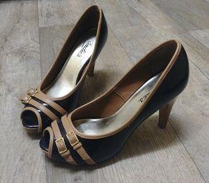 Candie's black and tan heels
